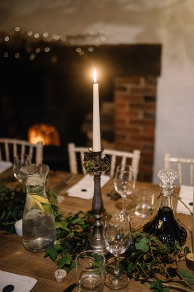Table plan styling at gothic wedding with candlelights and foliage decor