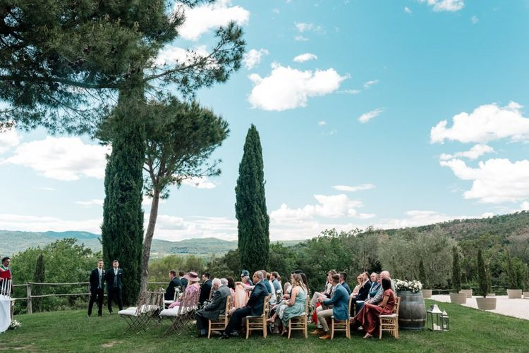 Guests Wait for Couple To Arrive For Outdoor Ceremony