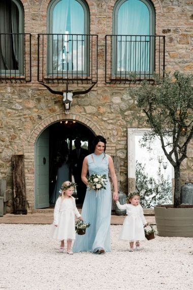 Bridesmaid In Blue Dress With Flowergirls Walk Down the Aisle