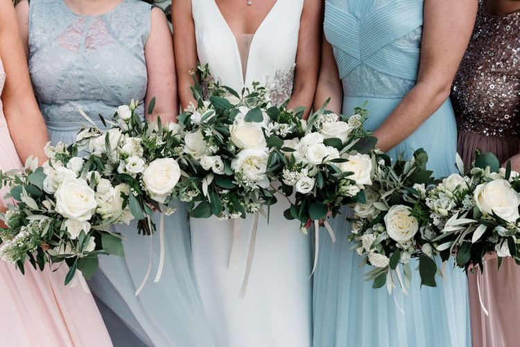 White Wedding Flowers with Blue Bridesmaid Dresses