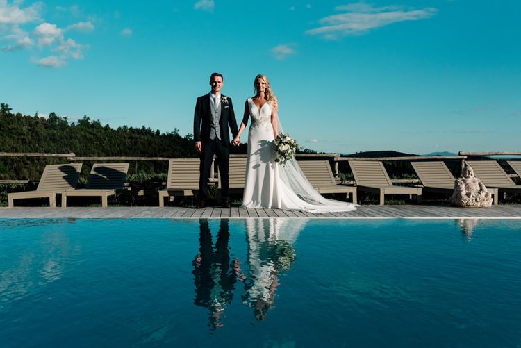 Bride and Groom Next To Pool For Tuscany Wedding