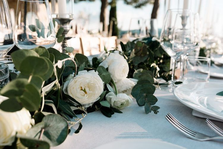Wedding Table Decor With White Flowers and Foliage