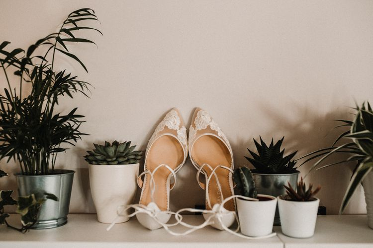 Ivory Bella Belle Wedding Shoes with Illusion Embroidered Lace and Ankle Ties   Festoon Light Canopy and Indoor Trees for Humanist Wedding in St Andrews   Carla Blain Photography