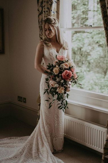 Wedding Bouquet with Coral and Blush Peonies with Blush Lace Wedding Dress