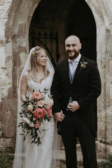 Bride and Groom After Ceremony with Peony Wedding Bouquet