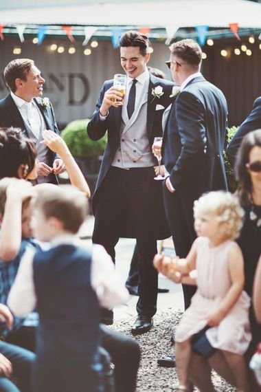 Pre-Ceremony Pint | Groom in Navy Tails and Grey Waistcoat | Lace Bridal Cape Veil & Fishtail Wedding Dress by Pronovias | On Love and Photography