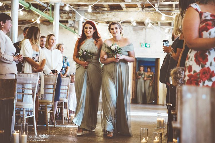 Wedding Ceremony at Holmes Mill | Bridesmaids in Fossil Green Multiway Dresses | Festoon Lights | Pillar Candles | Aisle Petals | Lace Bridal Cape Veil & Fishtail Wedding Dress by Pronovias | On Love and Photography