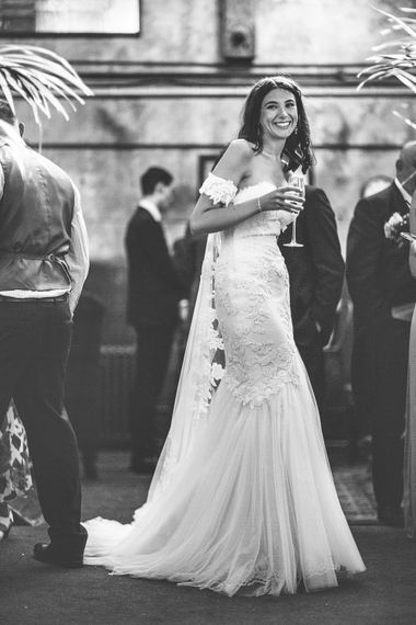 Bride in Fishtail Pronovias Wedding Dress with Off Shoulder Sleeves and Veil Cape | Bride Wearing Hair Down | Lace Bridal Cape Veil & Fishtail Wedding Dress by Pronovias | On Love and Photography