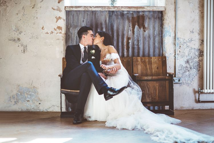 Bride in Fishtail Pronovias Wedding Dress with Off Shoulder Sleeves and Veil Cape | Groom in Navy Tails and Grey Waistcoat | Bride Wearing Hair Down | Lace Bridal Cape Veil & Fishtail Wedding Dress by Pronovias | On Love and Photography