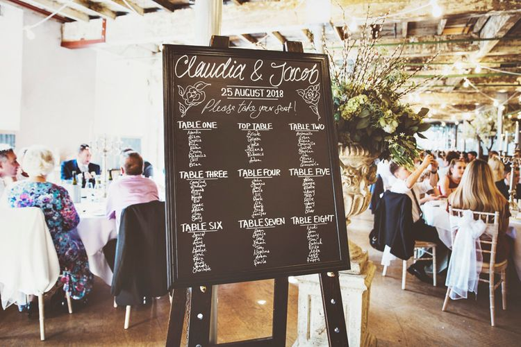 Chalkboard Wedding Seating Plan | Oversized Floral Urn | Lace Bridal Cape Veil & Fishtail Wedding Dress by Pronovias | On Love and Photography