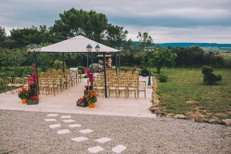 Outdoor Wedding Ceremony In South Of France With Bright Florals To Match Flower Crown