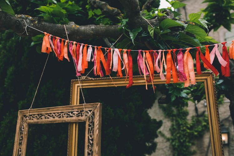Ribbon Bunting In Orange and Pinks To Match Flower Crown For Wedding