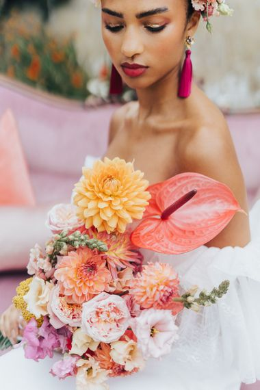 Blush wedding bouquet with anthuriums and dahlias