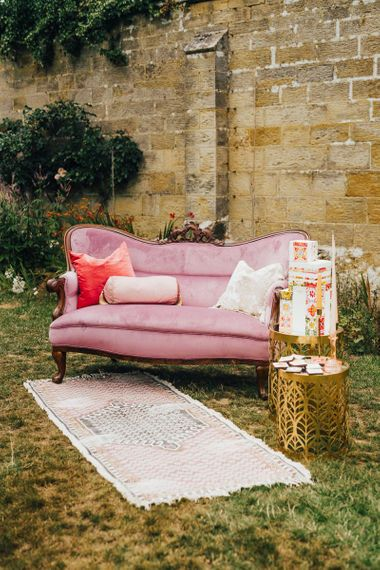 Pink velvet couch chill out area