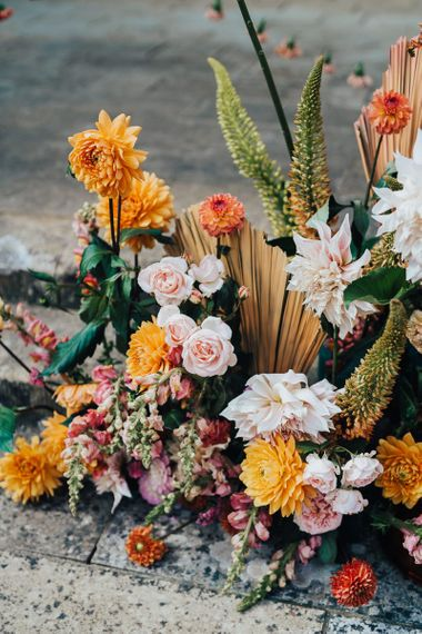 Tropical flower arrangements with roses and dahlias at Chiddingstone Castle