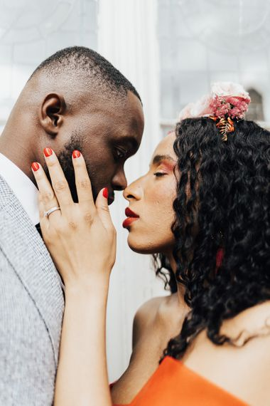 Intimate wedding portrait with bride wearing red nail polish