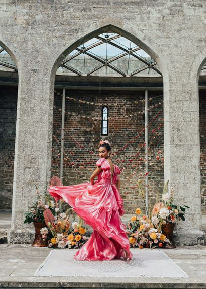bride in bright pink Emma Beaumont wedding dress at Chiddingstone Castle