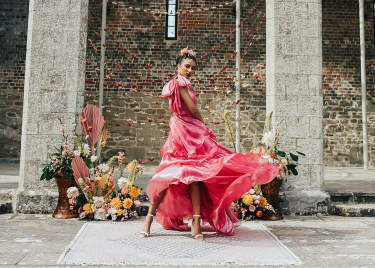 stylish bride in pink satin wedding dress by Emma Beaumont