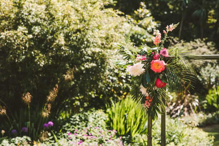 Pink and Orange Tropical Florals | Colourful Wedding Fiesta at Abbotsbury Wedding in Weymouth, Dorset | Photography by Paul Underhill.