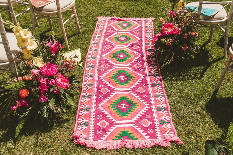 Stunning Pink White and Green Rug Runner for the Aisle | Colourful Wedding Fiesta at Abbotsbury Wedding in Weymouth, Dorset | Photography by Paul Underhill.