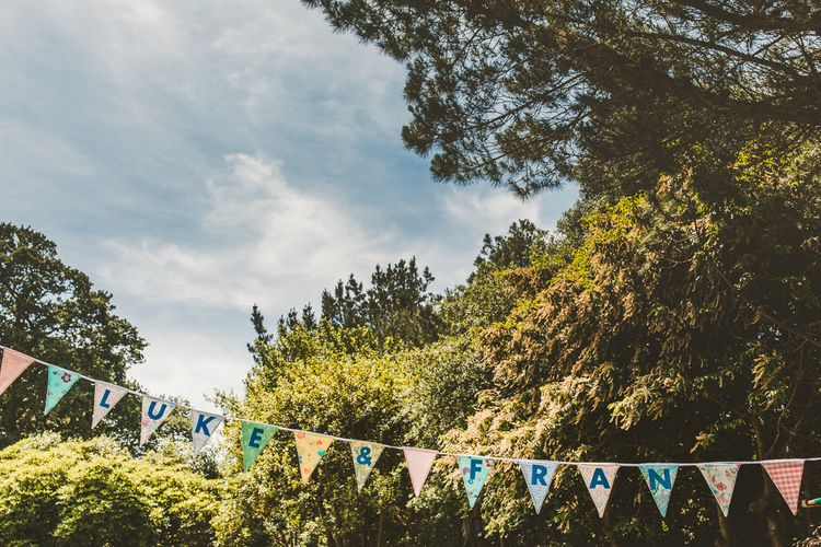 DIY Personalised Bunting | Colourful Wedding Fiesta at Abbotsbury Wedding in Weymouth, Dorset | Photography by Paul Underhill.