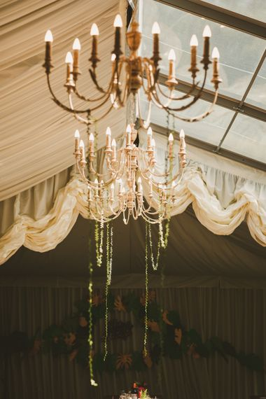 Marquee Decor with Gold Streamers | Colourful Wedding Fiesta at Abbotsbury Wedding in Weymouth, Dorset | Photography by Paul Underhill.