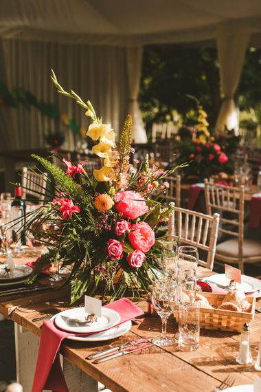 Pink and Yellow Large Floral Arrangements for Centre Pieces | Colourful Wedding Fiesta at Abbotsbury Wedding in Weymouth, Dorset | Photography by Paul Underhill.
