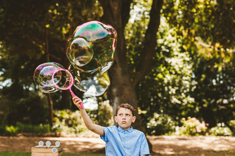 Giant Bubbles to Entertain | Colourful Wedding Fiesta at Abbotsbury Wedding in Weymouth, Dorset | Photography by Paul Underhill.