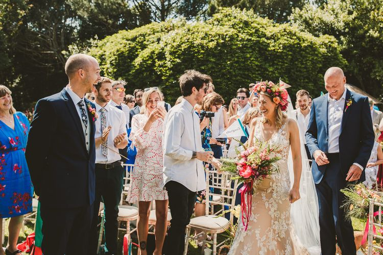 Outdoor Ceremony, Pink Ribbon Floral Bouquet | Colourful Wedding Fiesta at Abbotsbury Wedding in Weymouth, Dorset | Photography by Paul Underhill.