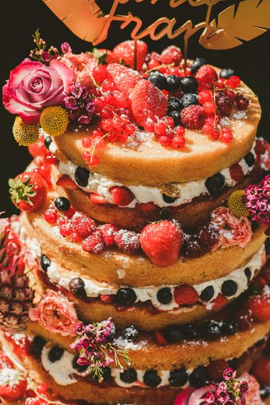 Naked Cake with Fruit | Colourful Wedding Fiesta at Abbotsbury Wedding in Weymouth, Dorset | Photography by Paul Underhill.