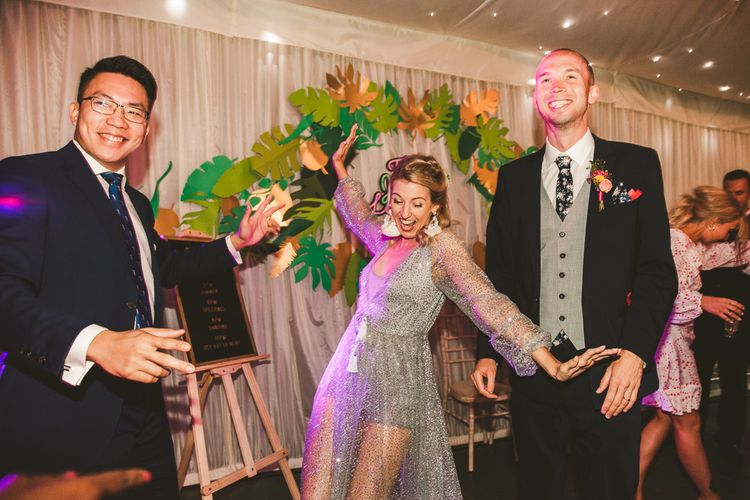 Bride Reception Outfit | Silver Sparkly Sheer dress with Hotpants | Colourful Wedding Fiesta at Abbotsbury Wedding in Weymouth, Dorset | Photography by Paul Underhill.