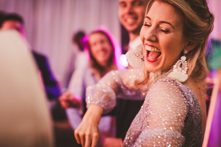 Dancing at the Reception | Colourful Wedding Fiesta at Abbotsbury Wedding in Weymouth, Dorset | Photography by Paul Underhill.