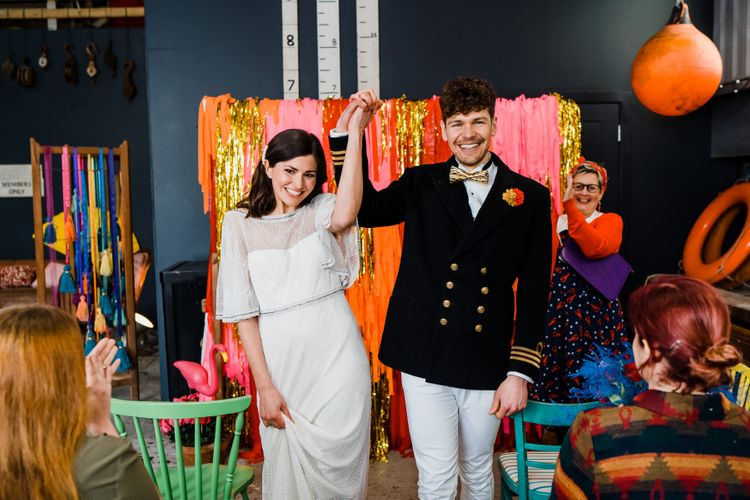 colourful wedding theme for ceremony at a boat shed