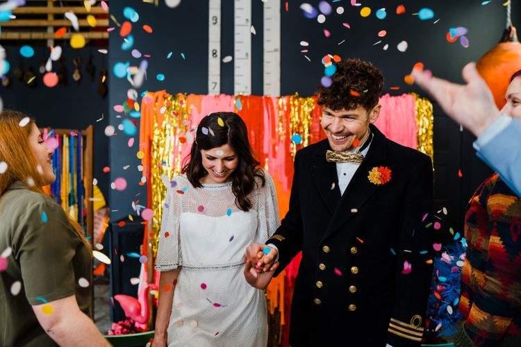 Confetti moment at boat shed wedding with colourful wedding theme