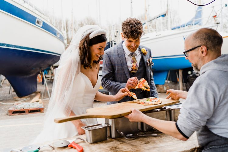 Bride and groom enjoying a pizza wedding breakfast