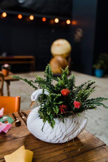 Plant in swan ceramic vase