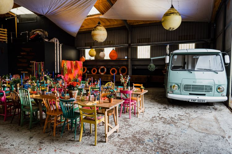 Industrial boat shed reception with colourful wedding theme