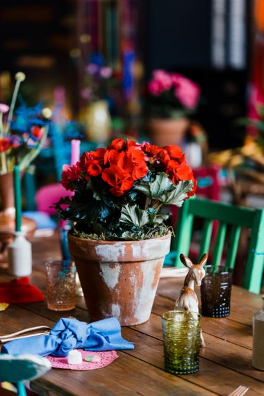 Red plant pot flower centrepiece