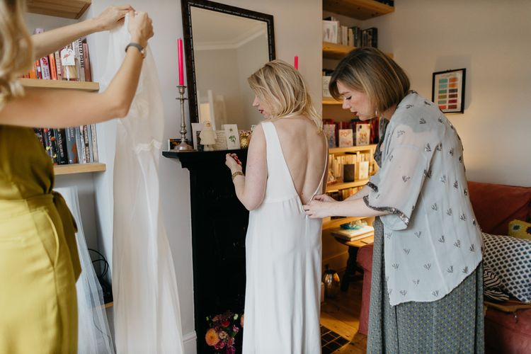 Bride getting ready in a Cathleen Jia dress for a colourful kitsch celebration in London