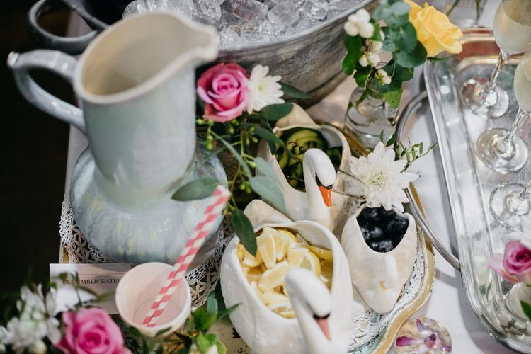 Ceramic animal pots and fun styling  for kitsch reception with pine cone wedding decor
