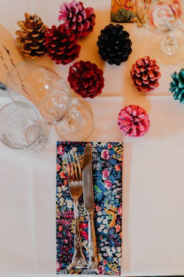 Spray painted pine cone wedding decor and handmade liberty print napkins