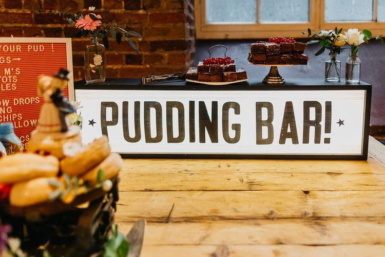 Pudding bar sign at bright and colourful kitsch wedding