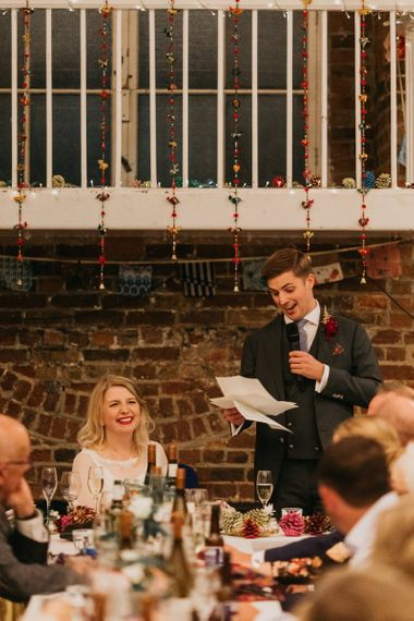 Grooms speech at colourful reception with bright and fun decor