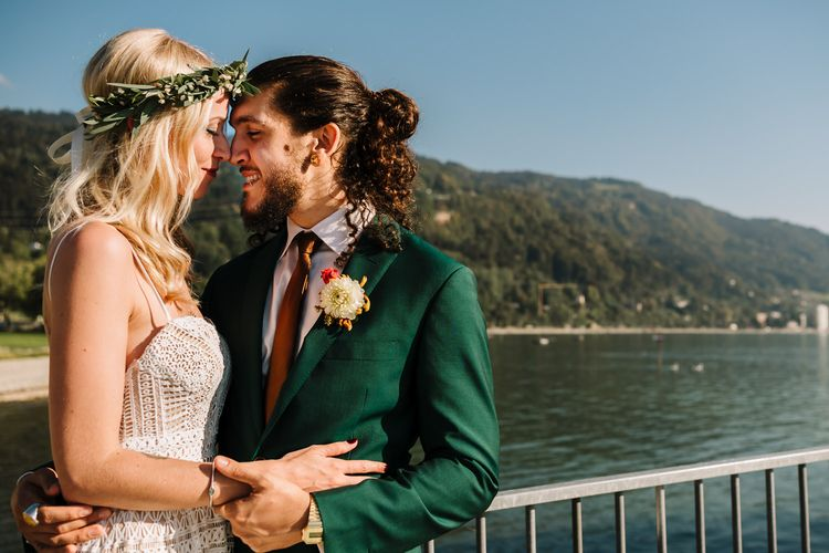Boho Bride in Lace Lillian West Wedding Dress and Flower Crown and Groom in Green Wedding Suit