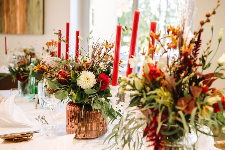 Red, White and Green Taper Candles and Floral Centrepieces