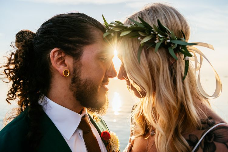 Boho Bride with Flower Crown and Groom in Green Wedding Suit