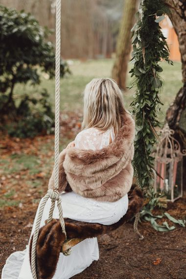 Boho Bride in ASOS Dress | Faux Fur Coverup | Greenery Swing Garland | Country Boho Inspiration in the Woodlands of Happy Valley Norfolk | Cara Zagni Photography