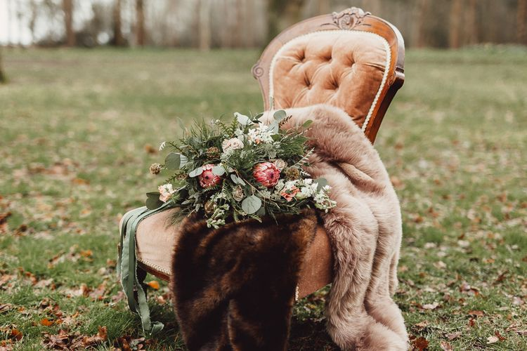 Foliage, Coral Flowers & Pheasant Feather Bouquet | Country Boho Inspiration in the Woodlands of Happy Valley Norfolk | Cara Zagni Photography