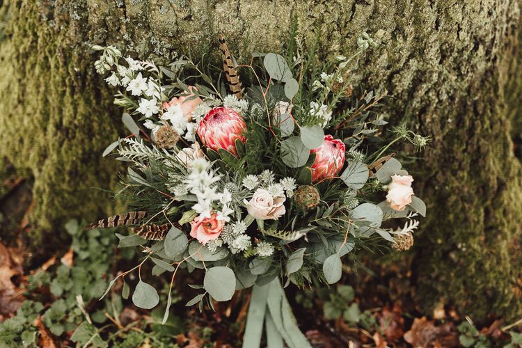 Foliage, Coral Flowers & Pheasant Feather Bouquet with Proteas | Country Boho Inspiration in the Woodlands of Happy Valley Norfolk | Cara Zagni Photography