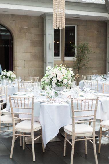 Neutral wedding flowers by Floribunda Rose at Hampton Manor image by Xander and Thea Wedding Photography